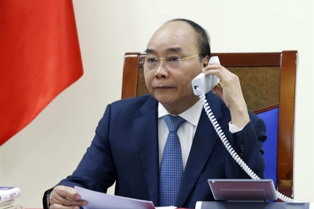 フック首相と安倍首相が電話会議、往来再開拡大で一致